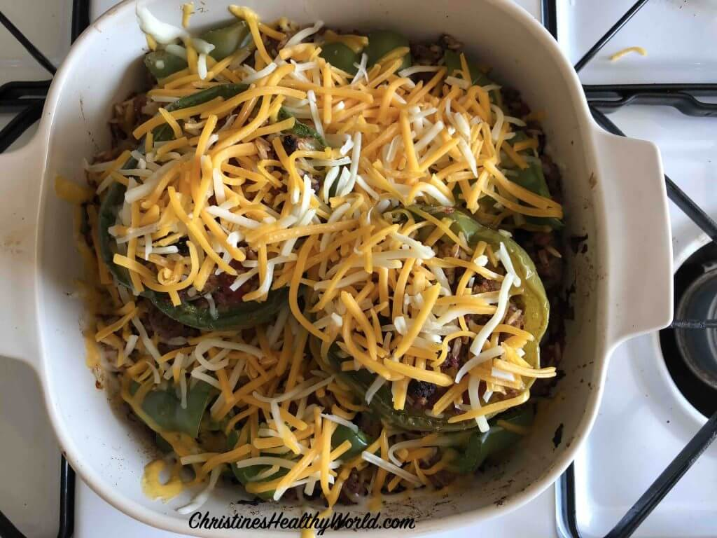 Stuffed Green Peppers sprinkle with cheese