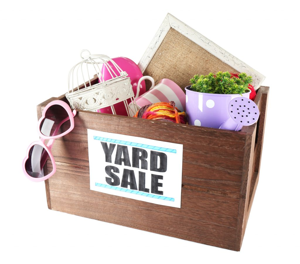 Declutter and downsize your stuff to get rid of everything by having a yard sale